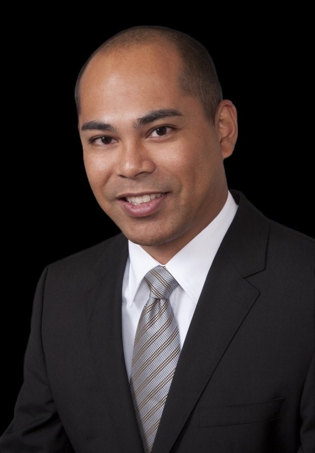 Headshot of Dr. Gary Gualberto with black background
